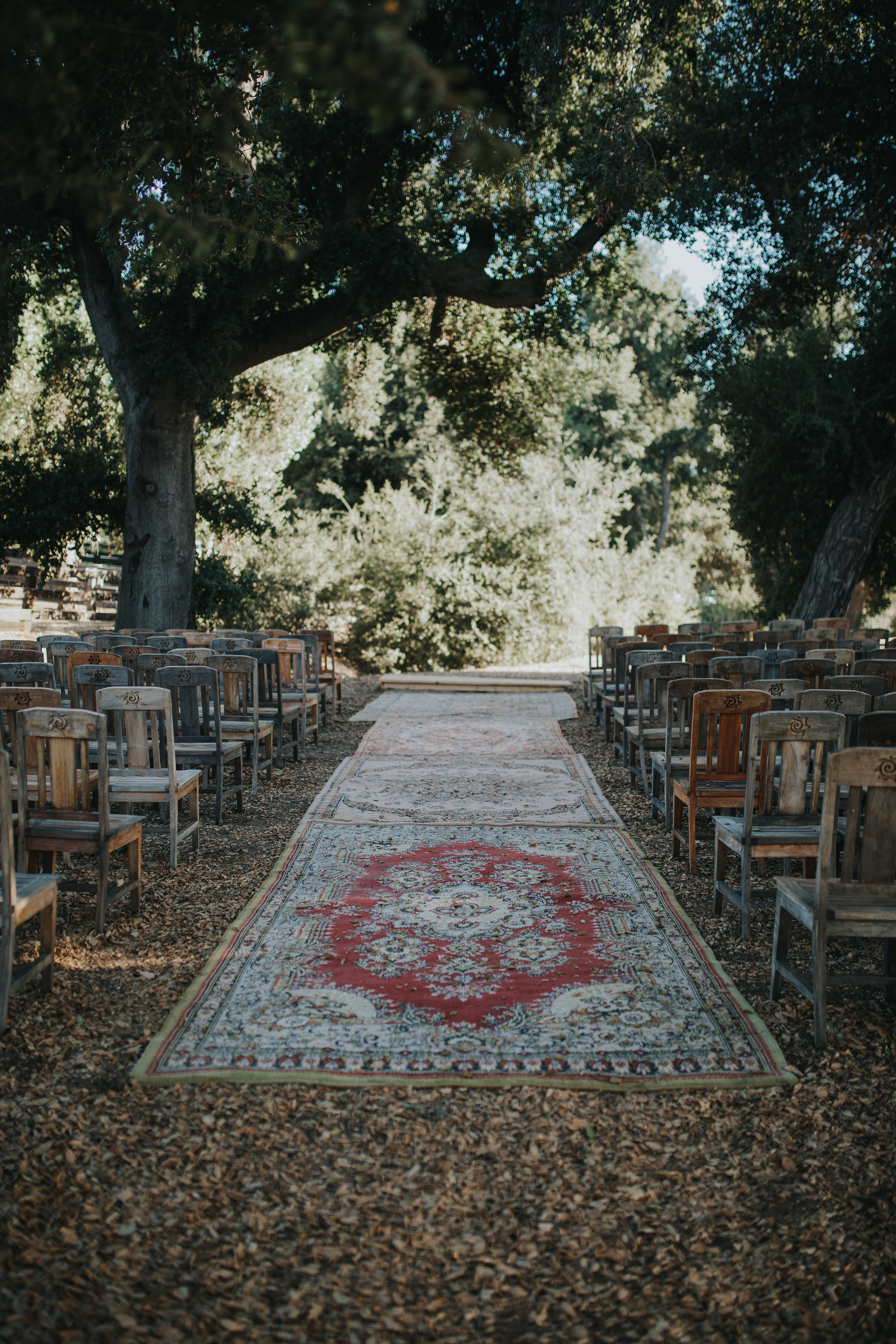 A wedding aisle made of vintage Persian carpets at a venue in Murrieta in the Temecula Valley. Chateau Adare is a private estate venue.