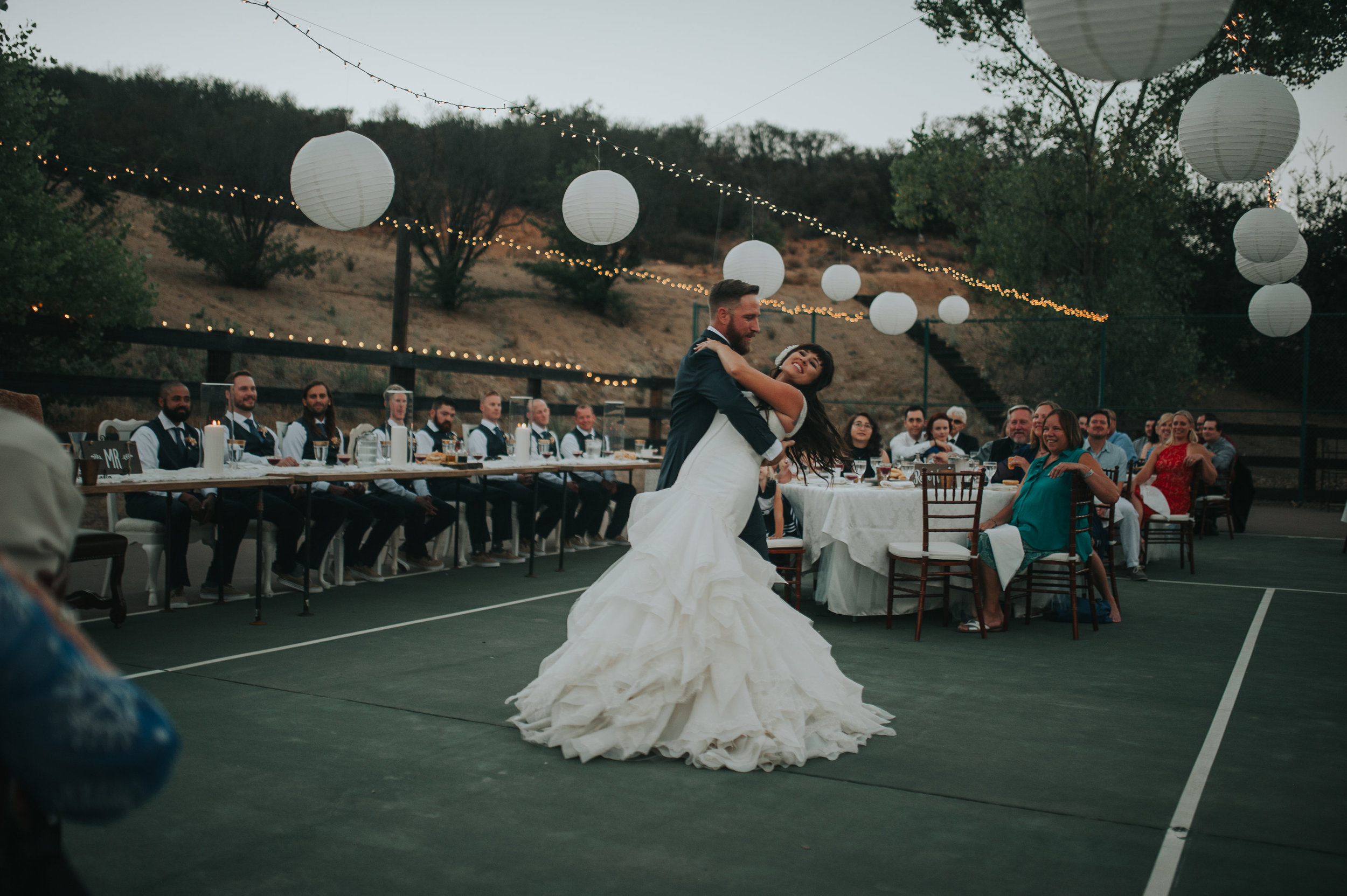 Bride and groom dancing at a wedding reception in Murrieta which is part of the Temecula Valley.