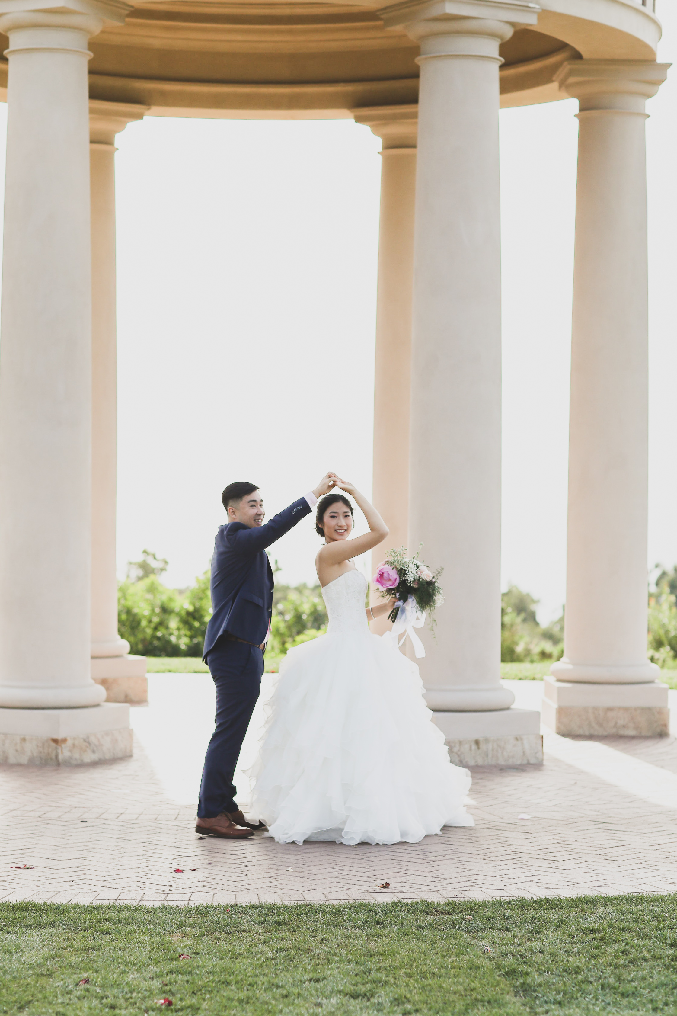 Bride and groom dance under the rotunda at the Resort at Pelican Hill in Orange County.