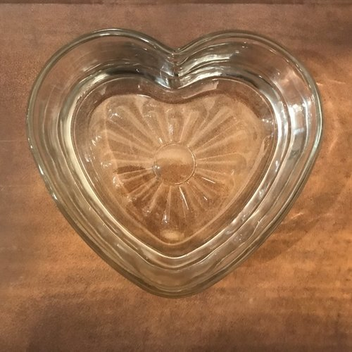 """Heart Candy Dish.    Glass heart bowls that are 6"""" in diameter at the widest point. A cute addition for any serving table. Great for condiments."""