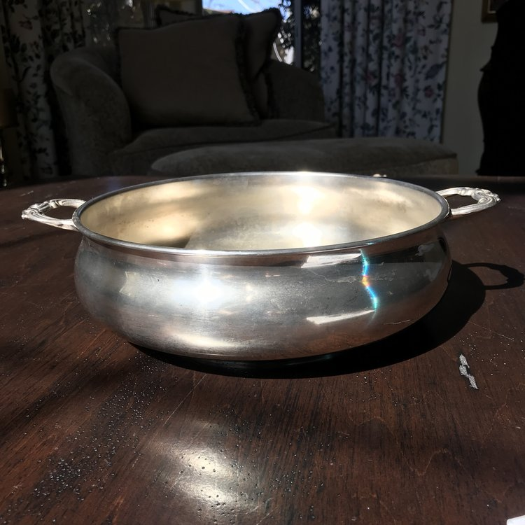 """Silver-plated Bowl with Handles    Vintage silver plated serving bowl with two handles on the side. Plain with no detailing. 11"""" round x 3"""" tall."""