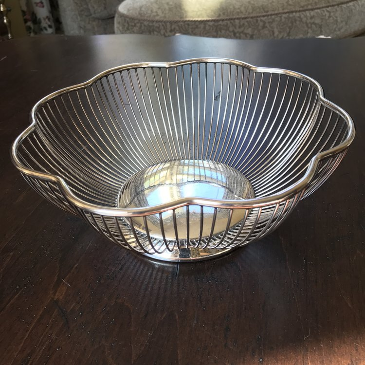 """Silver-plated Wire Bowls.   Assorted vintage silver plate wire bowls. Oval, heart, and floral shaped. Perfect for everything from petals to bread. Approximately 10"""" overall."""
