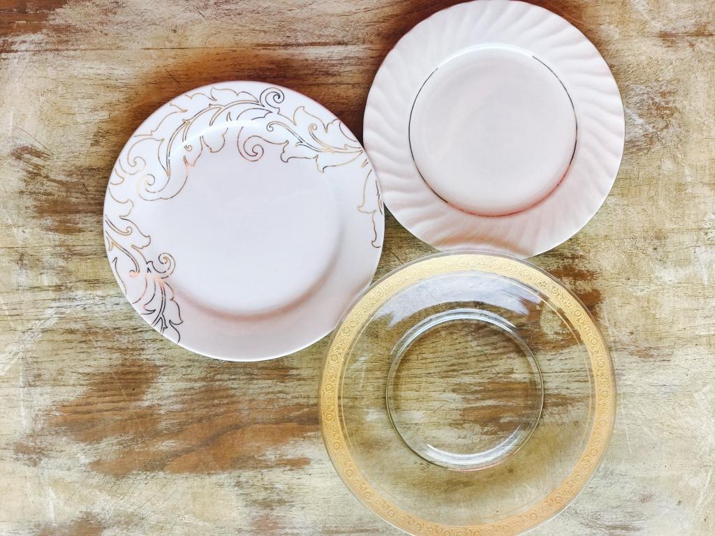 Mismatched gold china salad plates.