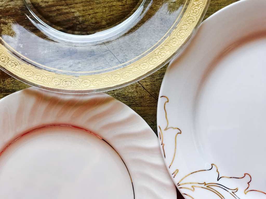 Mismatched gold and white china salad plates.