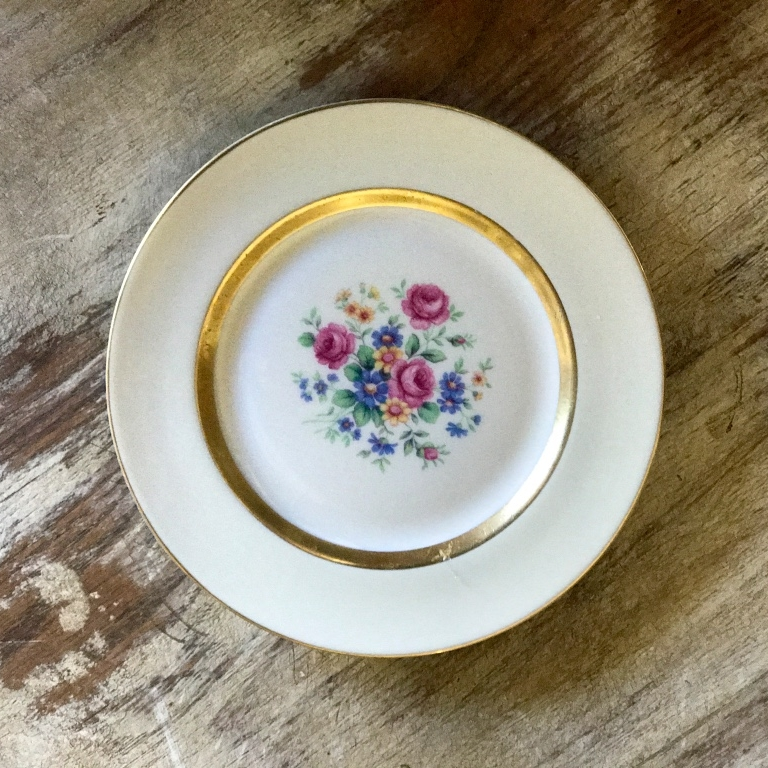 Mismatched vintage bread or appetizer plate In a pink floral pattern. Wedding rentals in the Temecula Valley.