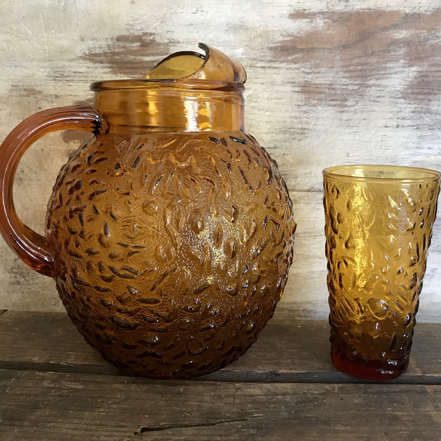 Mid Century Modern amber glass pitcher with matching tumblers. Vintage wedding rentals in The Temecula Valley.