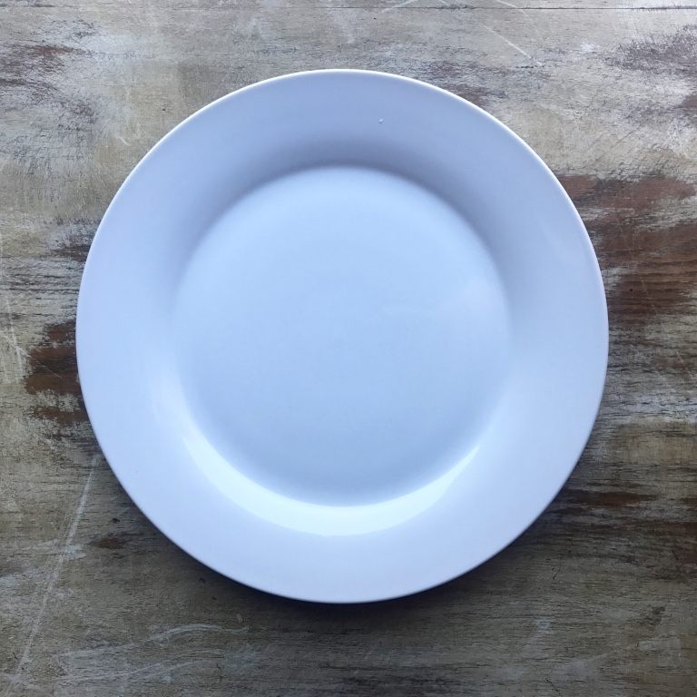 Classic white china dinner plates. Simplistic beauty. Wedding rentals in the Temecula Valley.