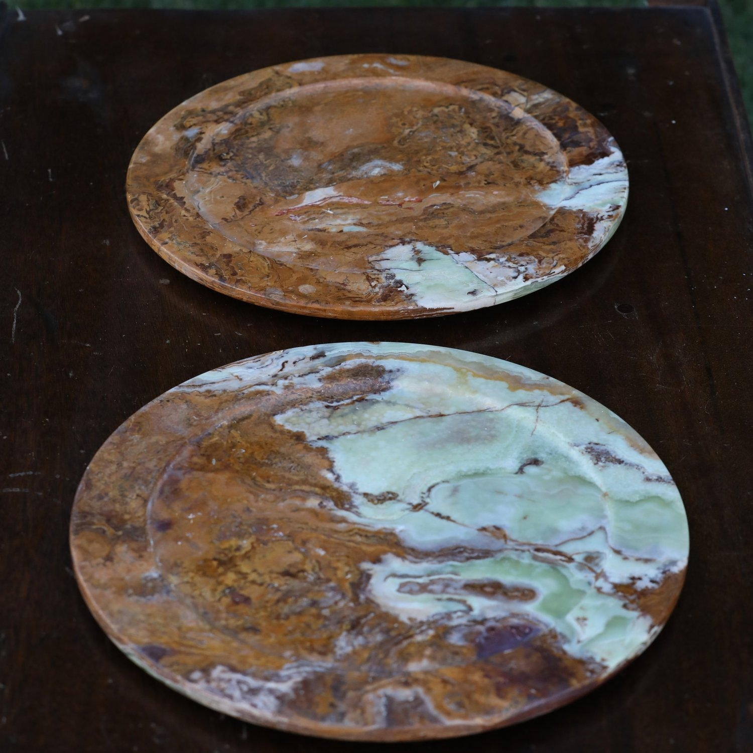 Dark granite natural stone charger plates. Marbled and heavy. Mismatched. Wedding and event rentals.