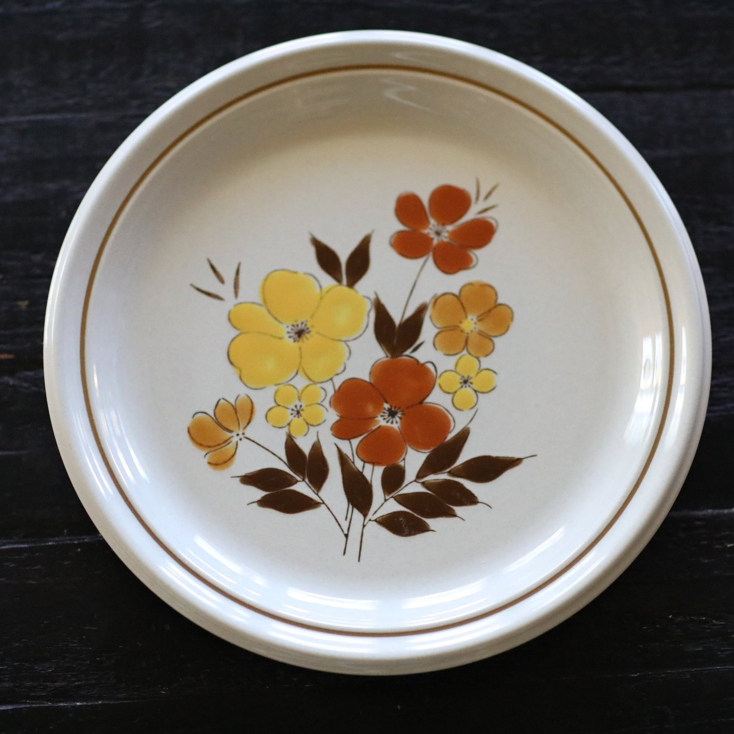 Stoneware, vintage and mismatched. Orange, yellow, rust flowers. Vintage rentals in the Temecula Valley.