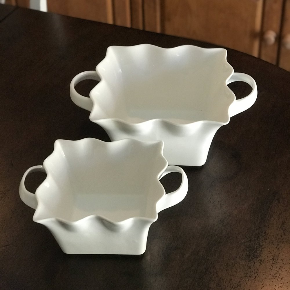 Two sizes of ruffled edge serving bowls in white with two handles. Wedding rentals in Murrieta.