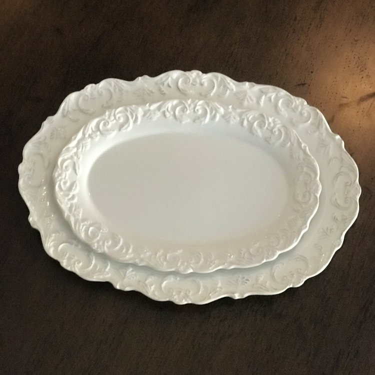 "White Scalloped Oval Platter   Two sizes: 16"" x 11.5"" and 12.5"" x 8.5"". Rented as a pair."