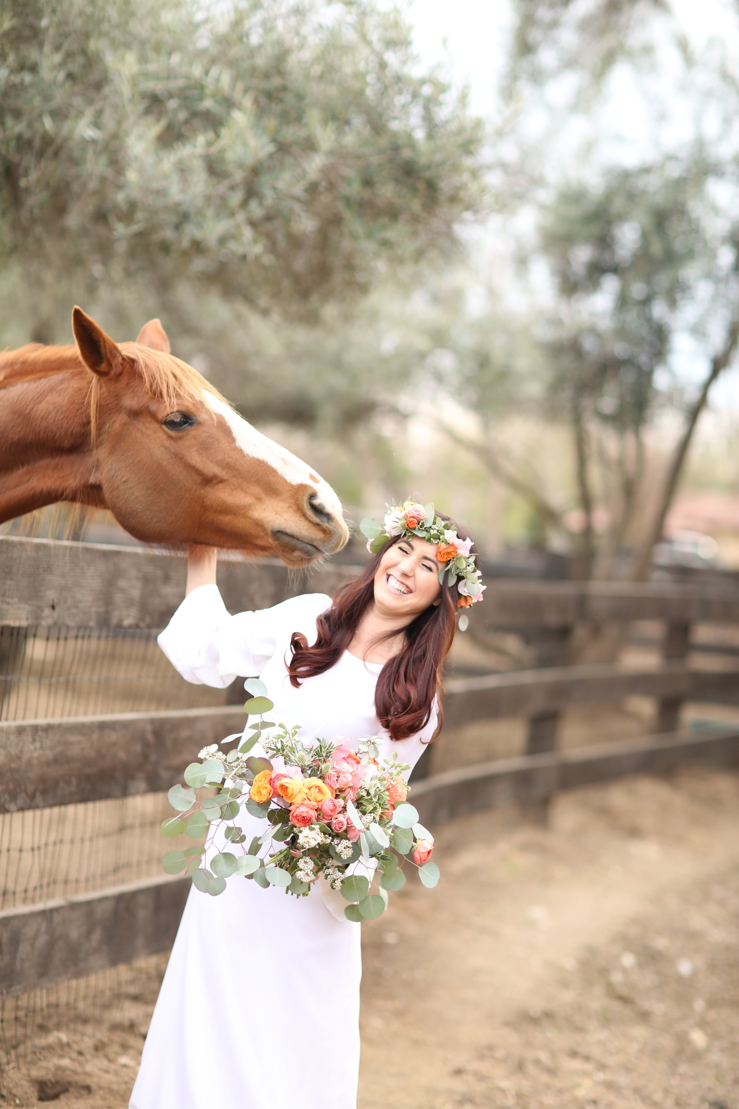 Horse at Chateau Adare in Murrieta eating brides flowers as she cracks up about it.