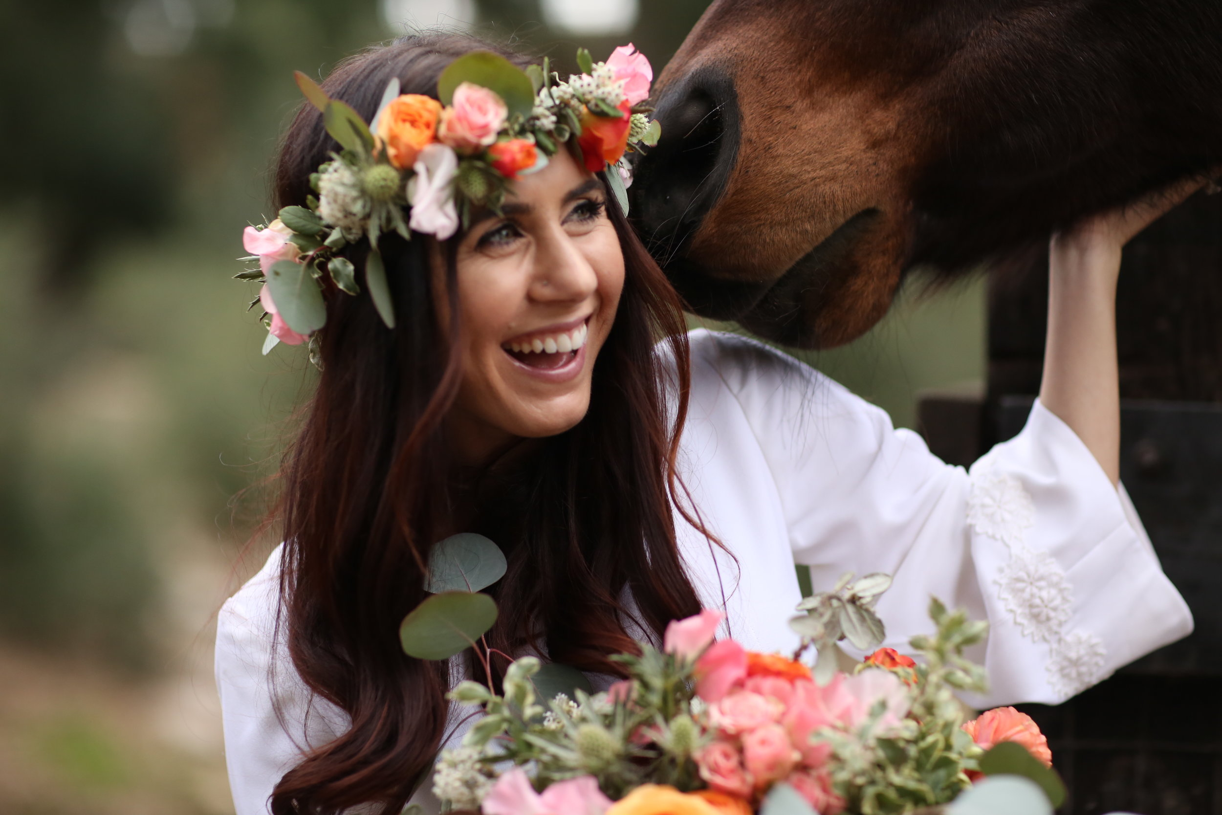 Horse eating brides flowers at the private estate wedding venue, Chateau Adare in Murrieta.
