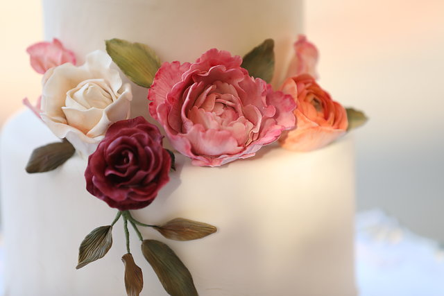 Wedding cake with real looking gum paste flowers.