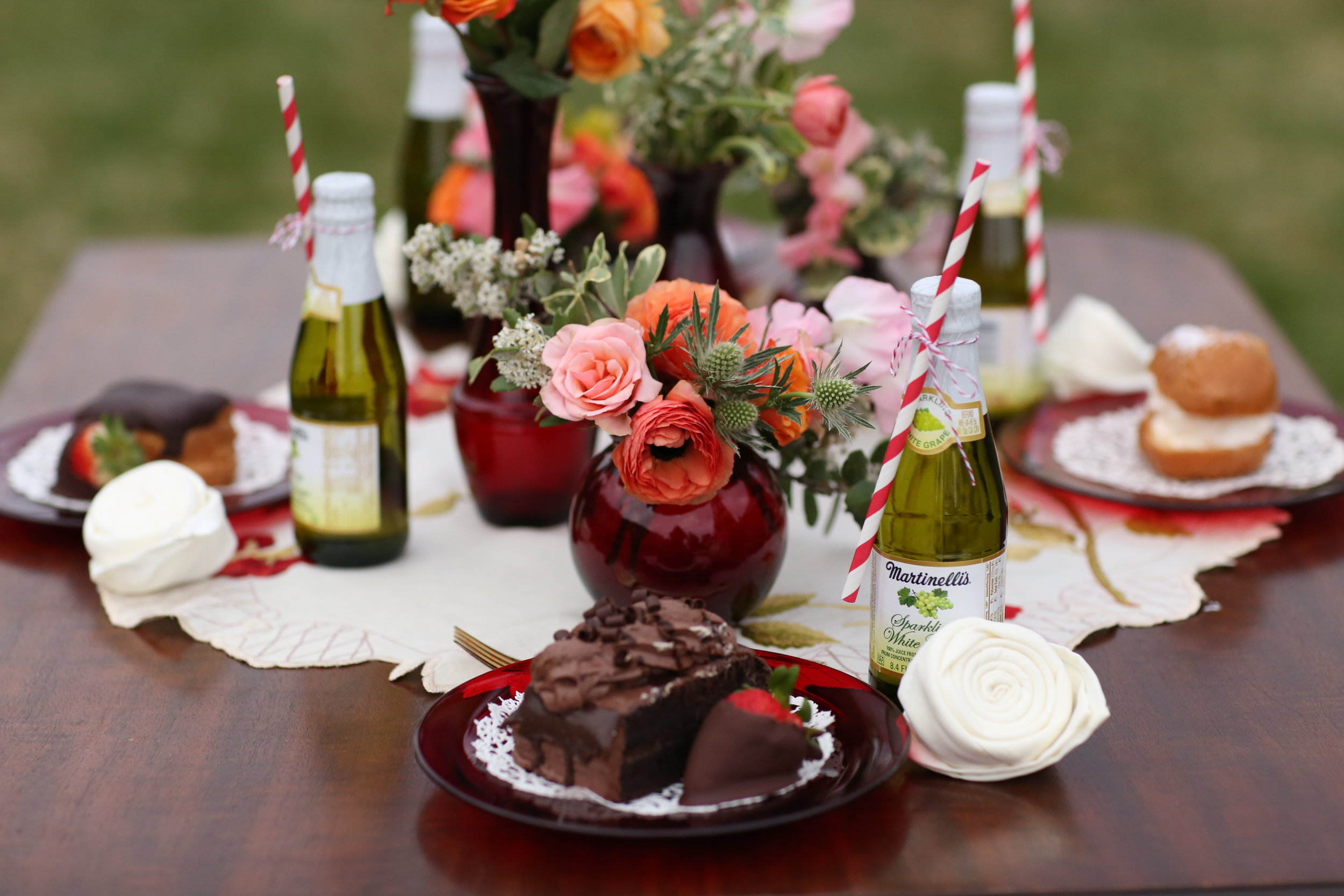 Vintage table top with ruby glass. antique doily, ruby glass plates, Martinelli's, all available to rent in Murrieta at Birdie in a Barn.