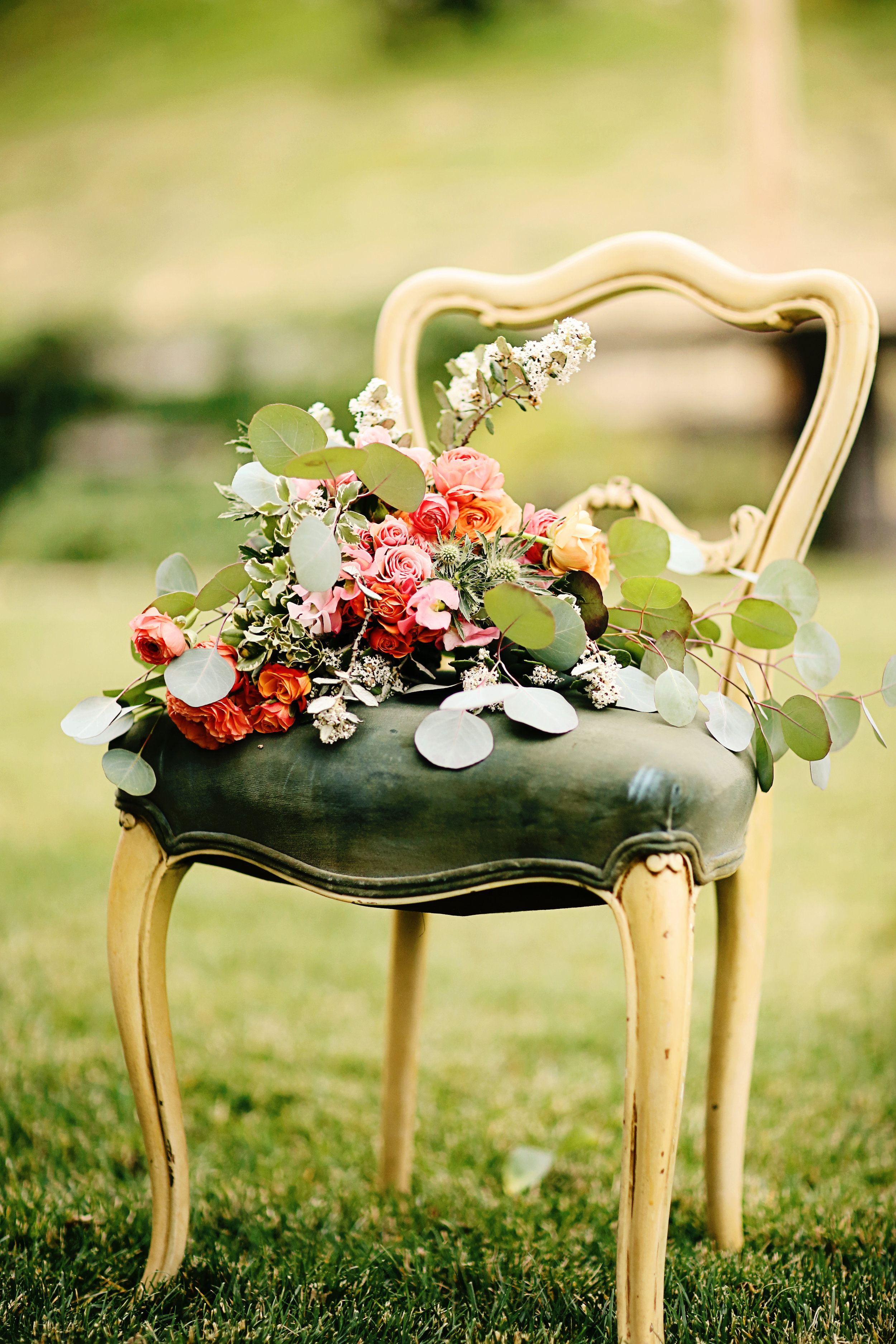 Vintage French provincial chair with a velvet seat. Brides bouquet sitting on the chair. Vintage wedding furniture rental in The Temecula Valley.