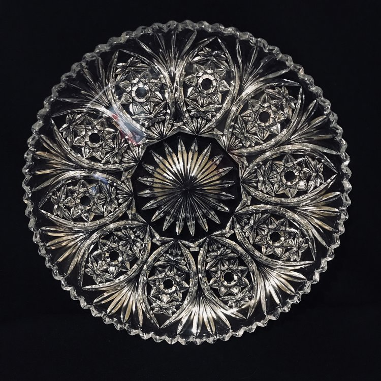 "Double Star Platter.   Intricate cut glass double star pattern platter with a saw tooth edge. 11.25"" round."