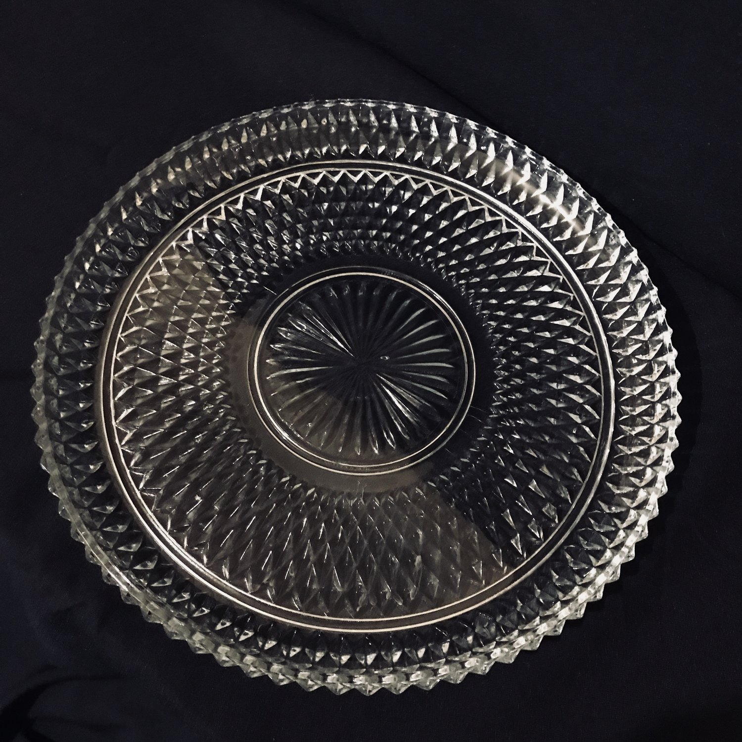 "Sawtooth Platter   Diamond pattern cut glass platter with a starburst center and a saw tooth edge. 12.5"" round."