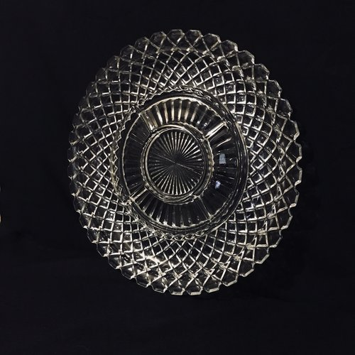 "Diamond Relish Platter.    Cut glass relish plate with a flat diamond edge. Divided plate with a diamond patterned outer rim. 14"" round."