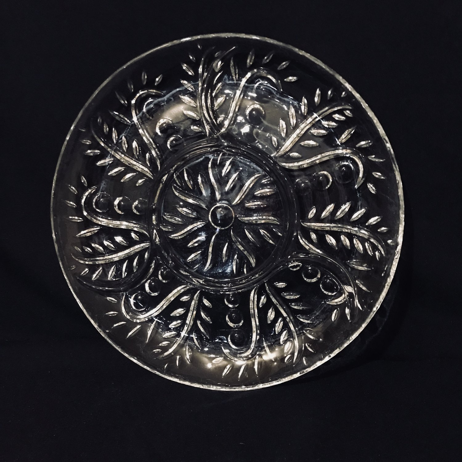 "Fern Relish Platter.    Cut glass relish platter with a swirling fern pattern. 11.5"" round."
