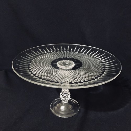 "Diamond Pedestal Platter.    Cut glass diamond pattern pedestal platter with very ornate pedestal. 12.5"" round x 8"" tall."