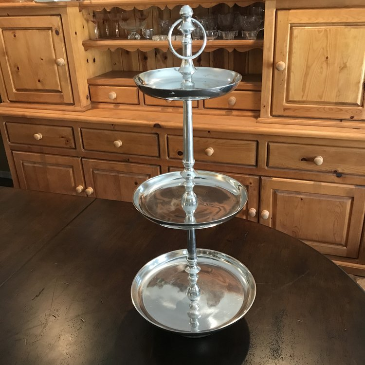 "Stainless Three Tiered Tray    Three tiered polished silver stainless steel serving tray. Perfect addition to your appetizer or dessert bar. 29"" tall x 12"" bottom, 10"" middle, 8"" top."