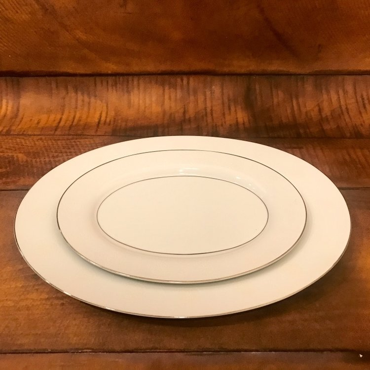 Mismatched vintage silver rimmed china platters. Wedding Rentals in The Temecula Valley.