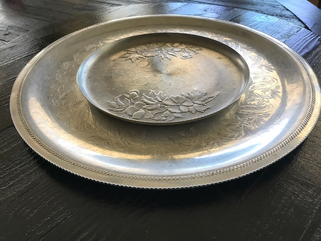 Round aluminum platters with etched flowers