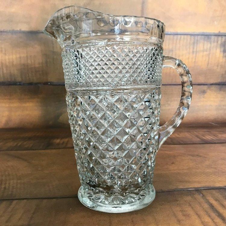 Glass Pitcher    Assorted mismatched glass pitchers.