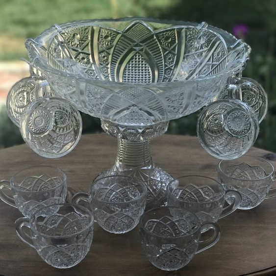 Punch Bowl Set.    Cut glass punch bowl on a decorative base. Comes with 10 matching cups.