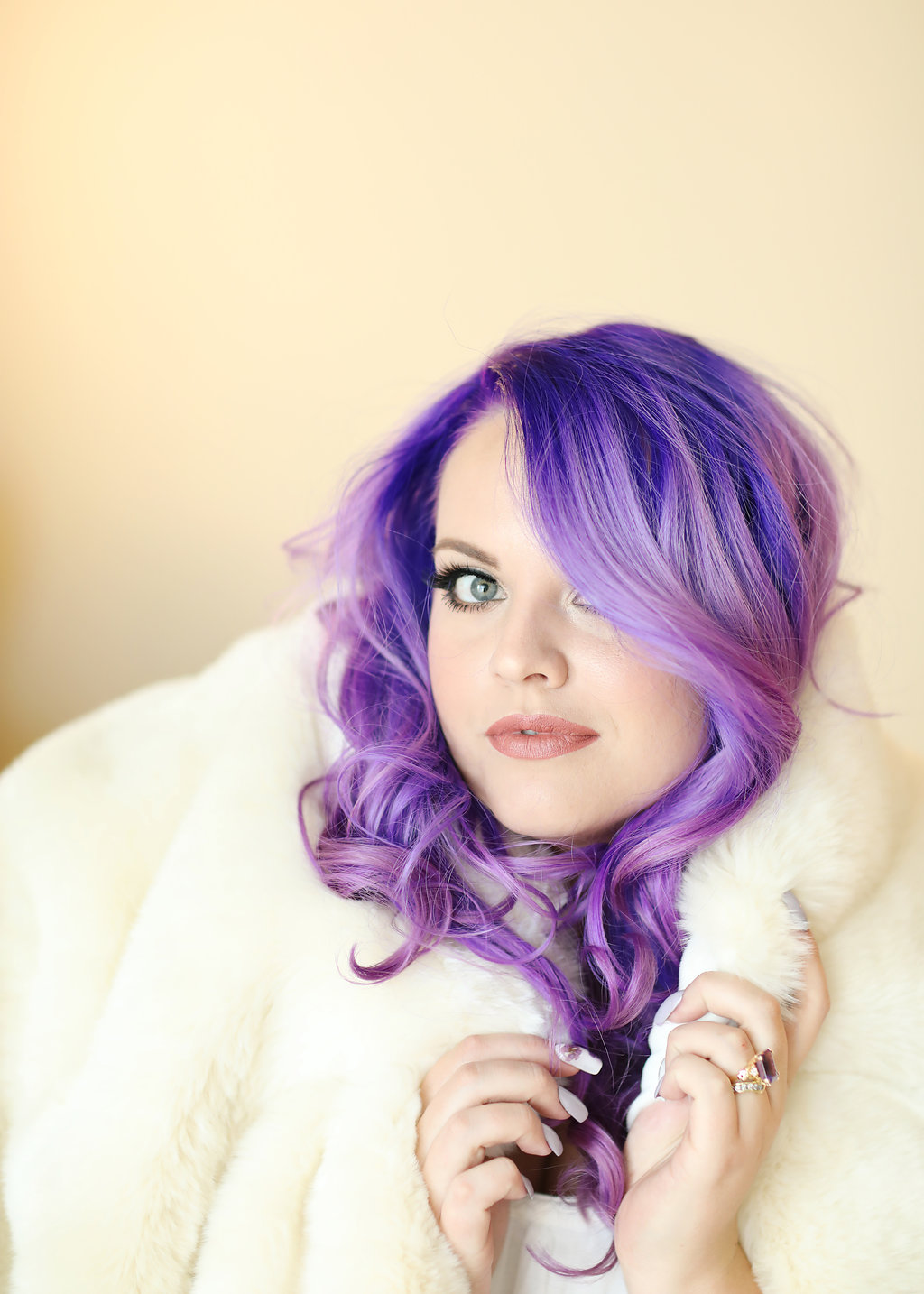 Wrapped in a white fur, this Ultra violet haired bride poses at Chateau Adare in the Bridal Suite. Part of the Temecula Valley.