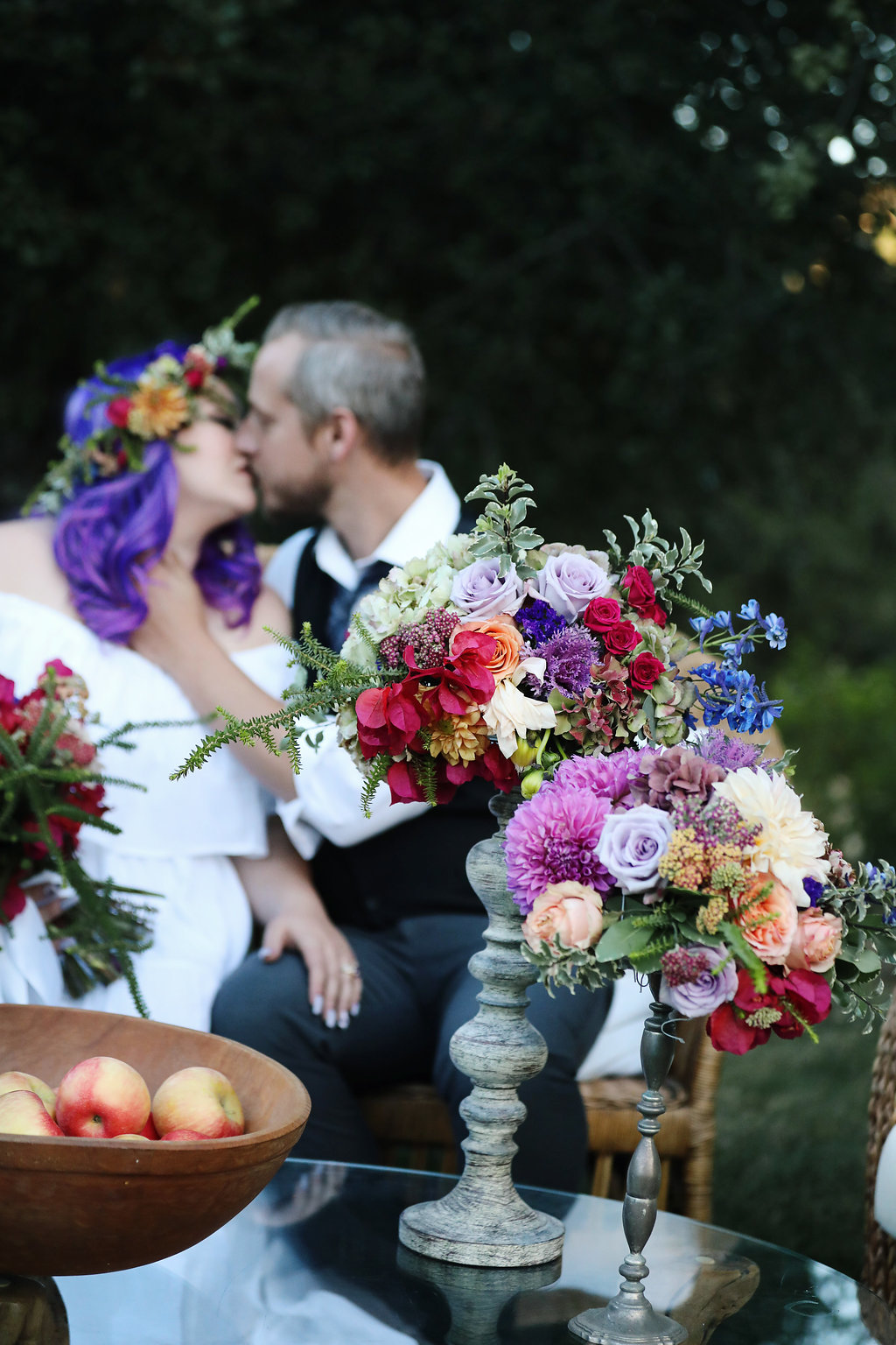 Tall colorful floral arrangements found on a mid century modern table during a bridal photo shoot. The bride had fabulous ultra violet hair. Location was Chateau Adare in the Temecula Valley.