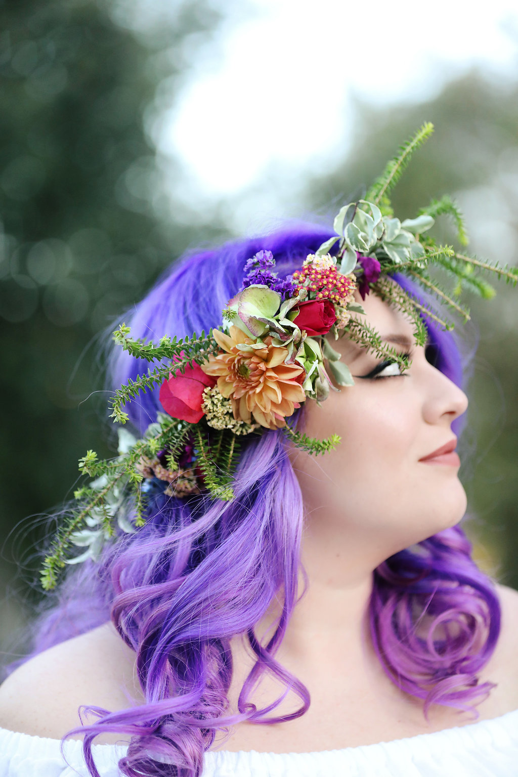 The ultra violet hair on this beautiful bride was framed perfectly with the bohemian floral crown she wore.
