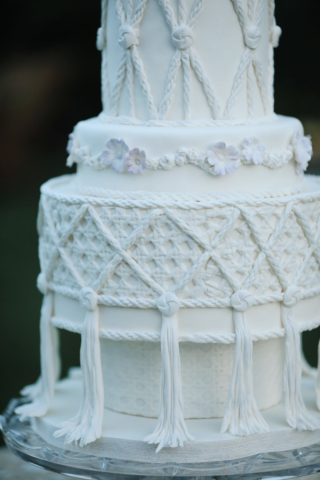 Macrame wedding cake details on top of cut glass cake plate from Birdie in a Barn vintage rentals in the Temecula Valley.