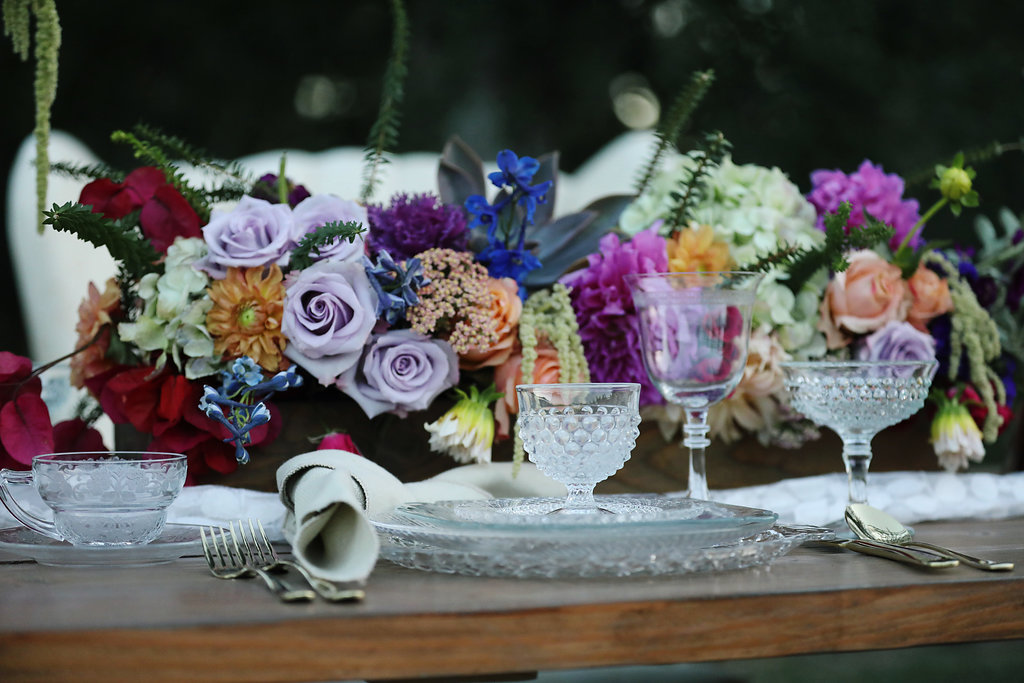 Vintage cut glass by Anchor Hocking set on an Industrial Farm table for a wedding party.