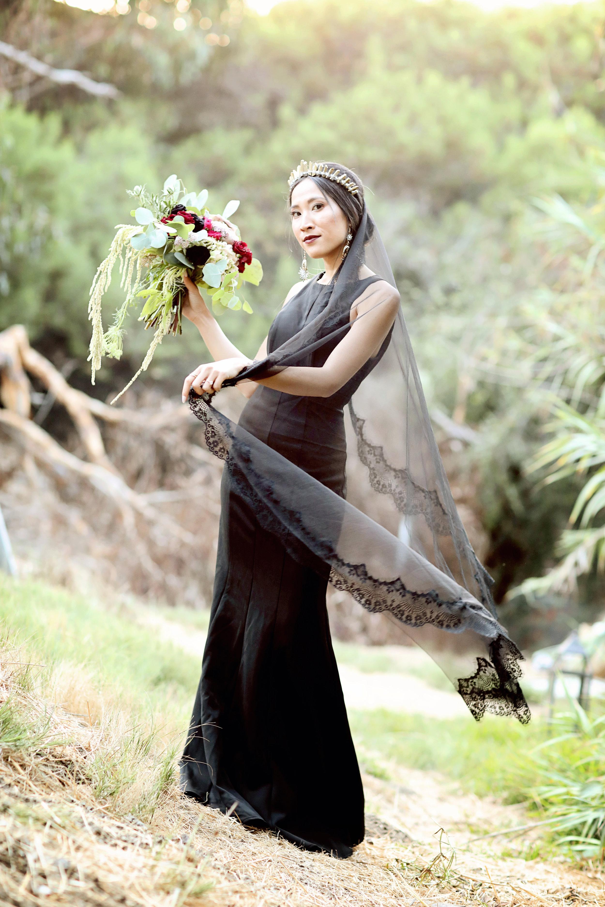 Orange County Bride wearing a black wedding dress and a black veil.