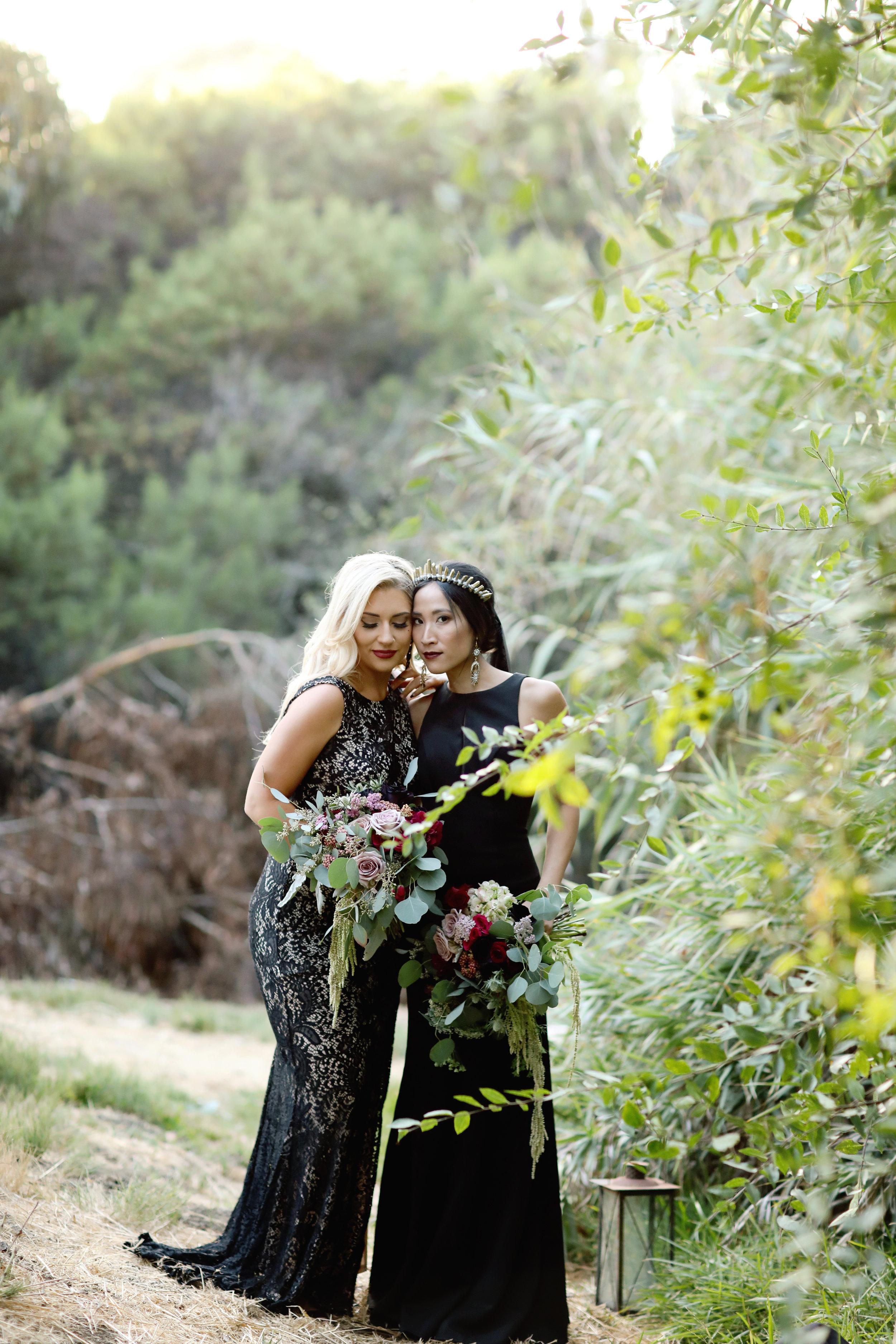 LGBT Brides in black wedding dresses.