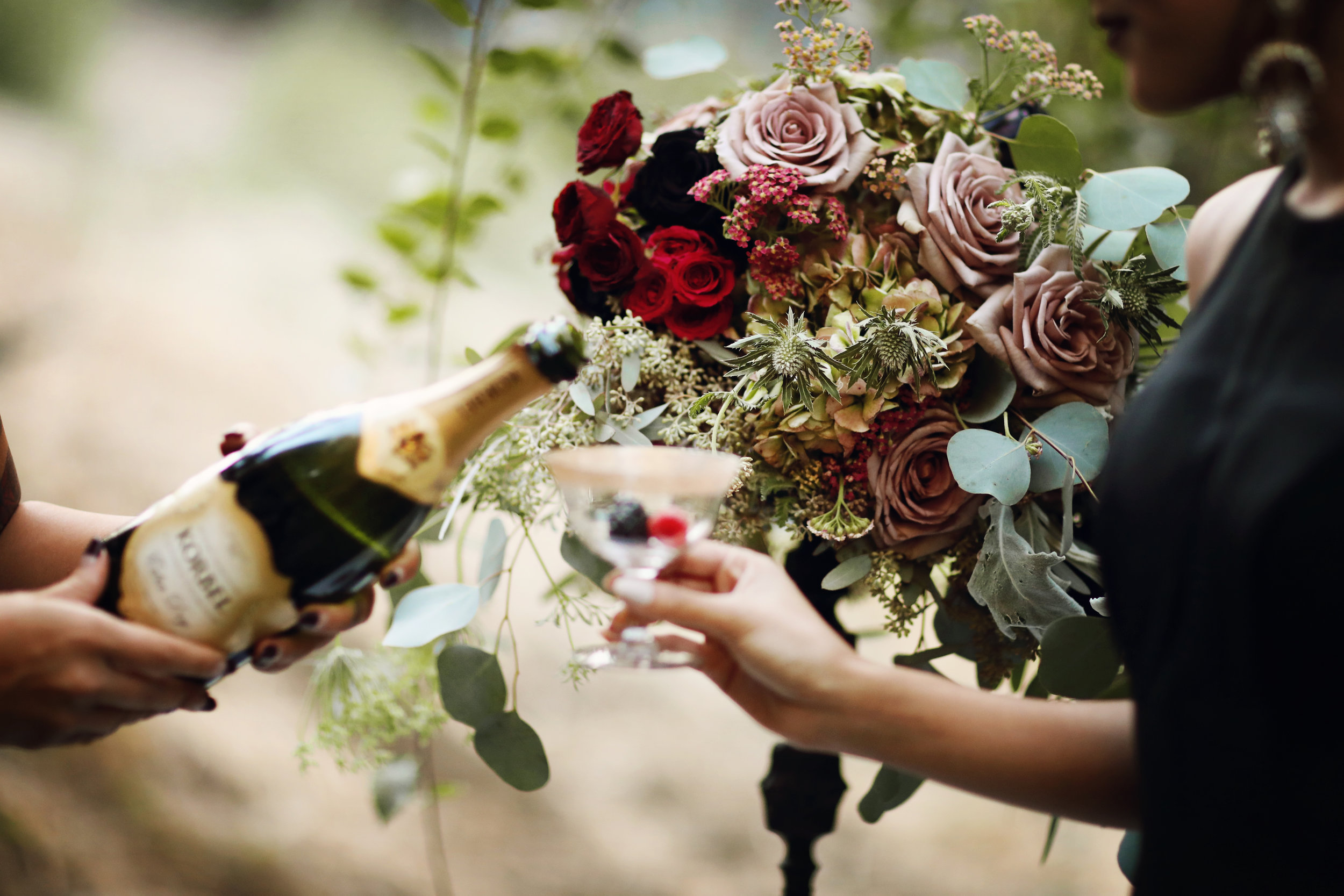 Floral centerpiece with black dahlias, gold rimmed champaign goblets from Birdie in a Barn.