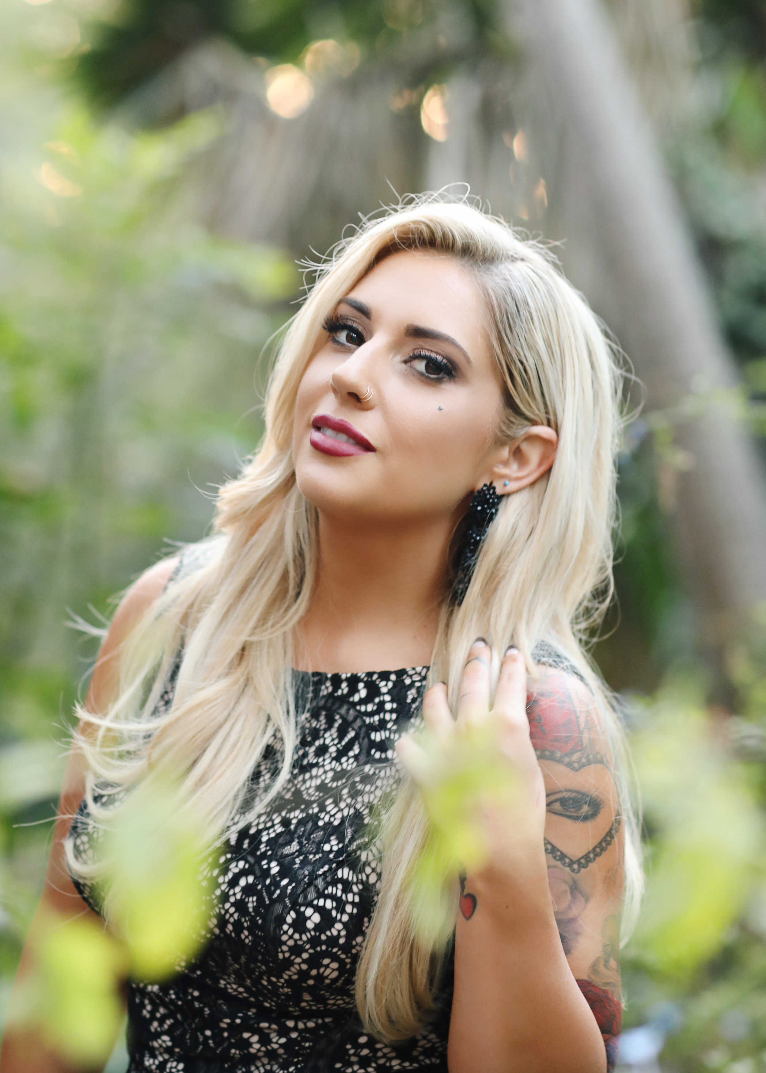 Blond haired bride in a black wedding dress. Tattoos.