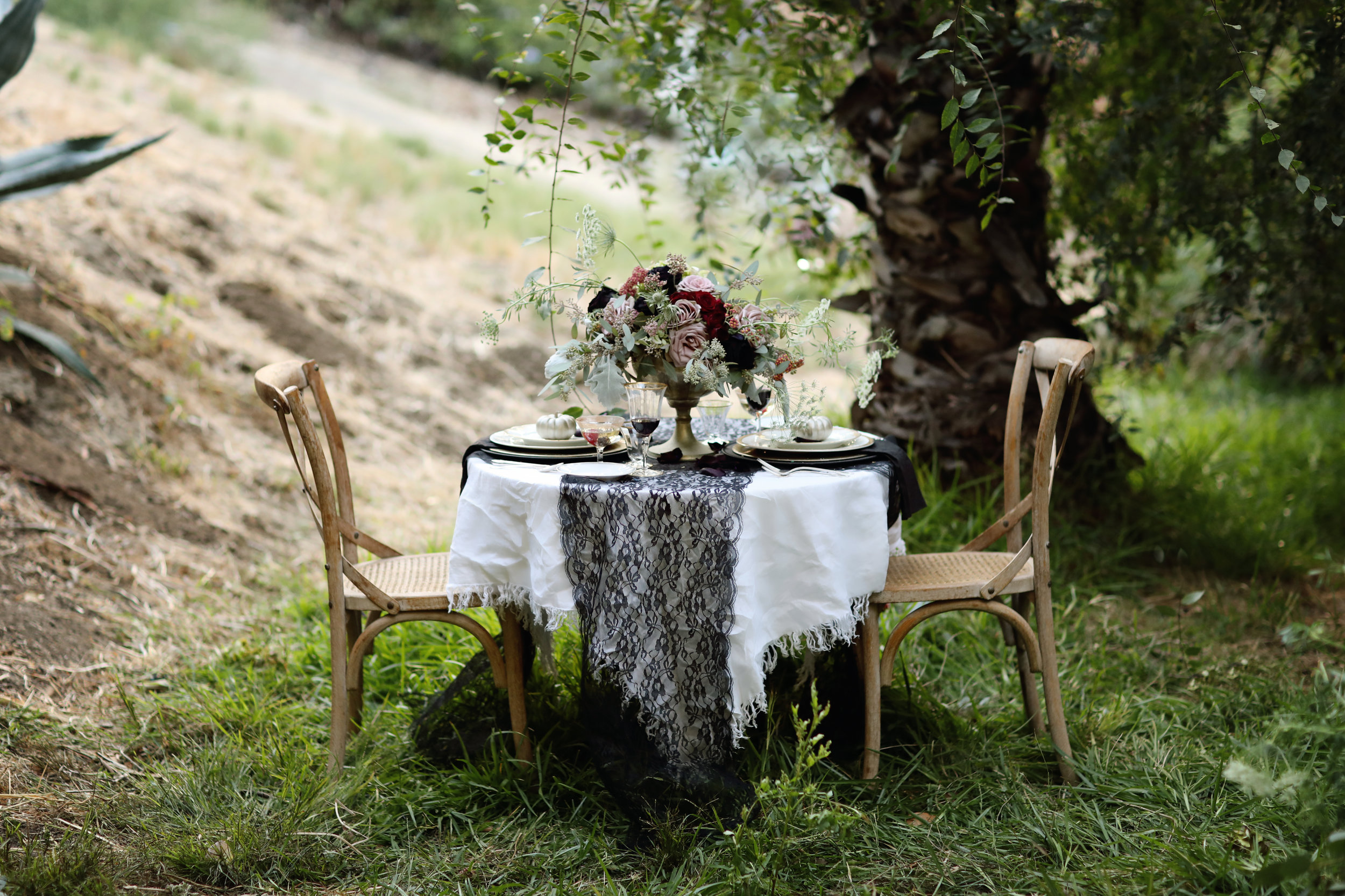 Intimate wedding table with gold china and crystal. Wedding rentals from Birdie in a Barn vintage rentals.