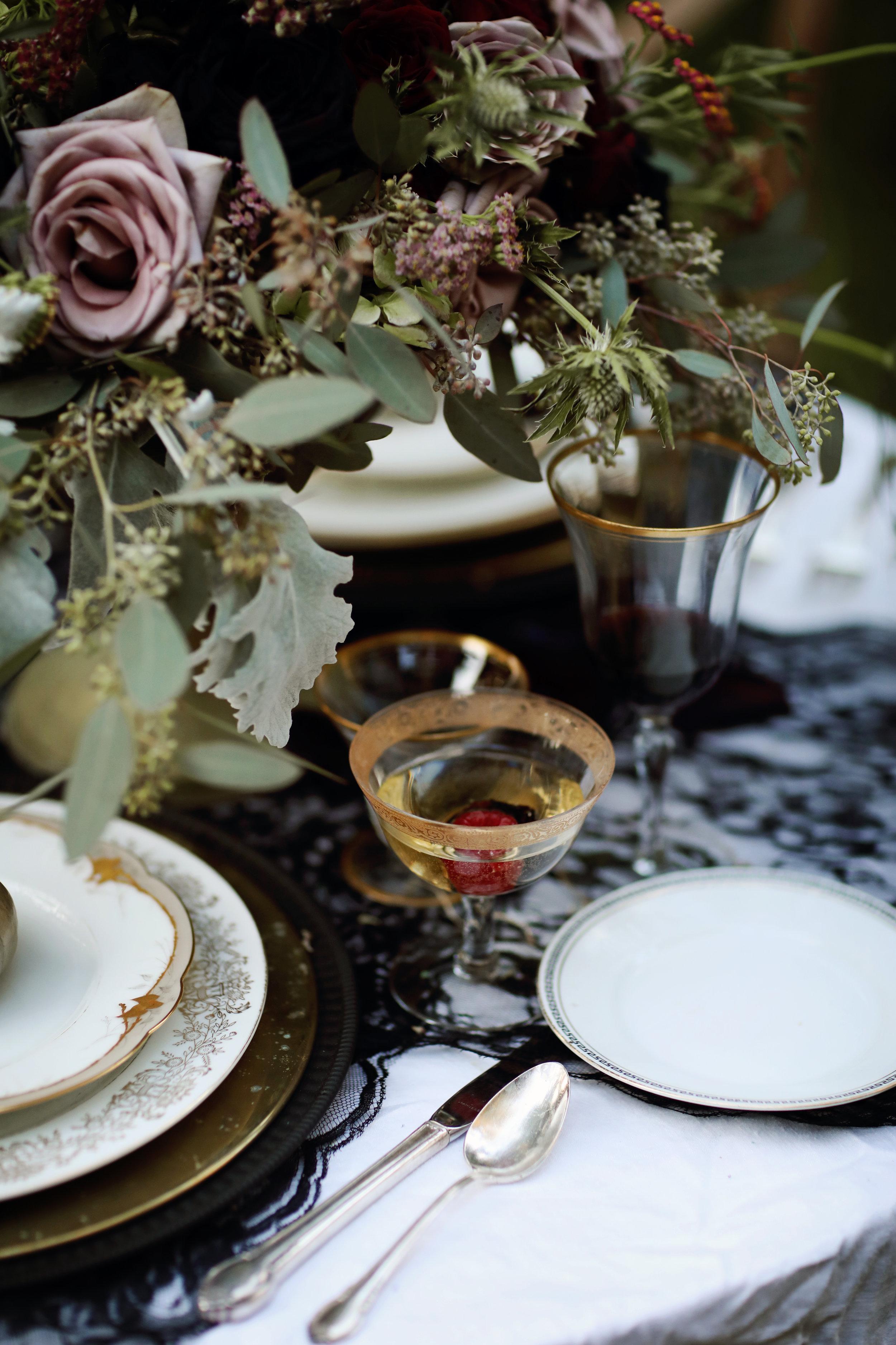 Gold china, gold charger, vintage silverware, gold rimmed goblets, vintage wedding rentals.