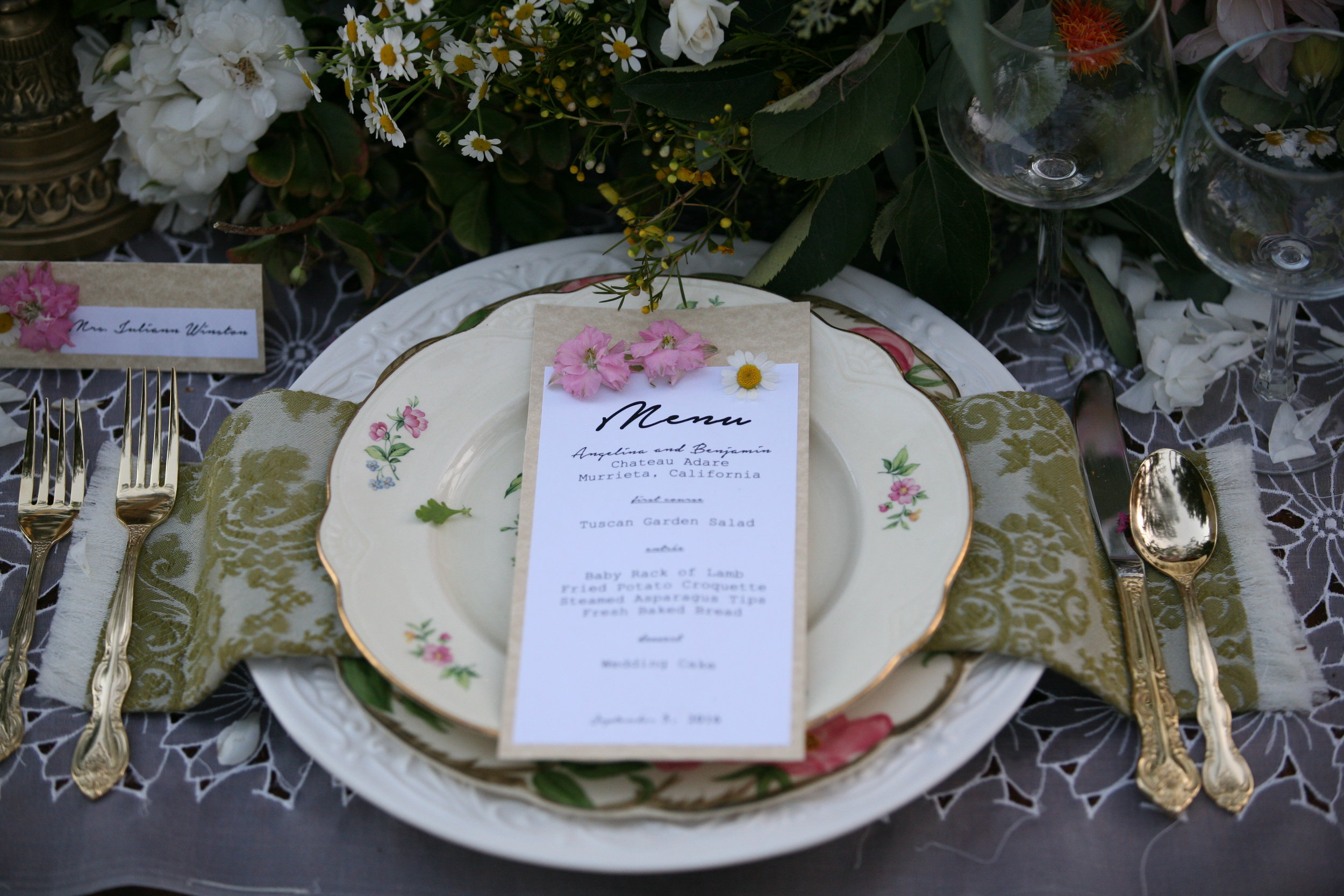 White charger plate is the base of this wedding table setting.