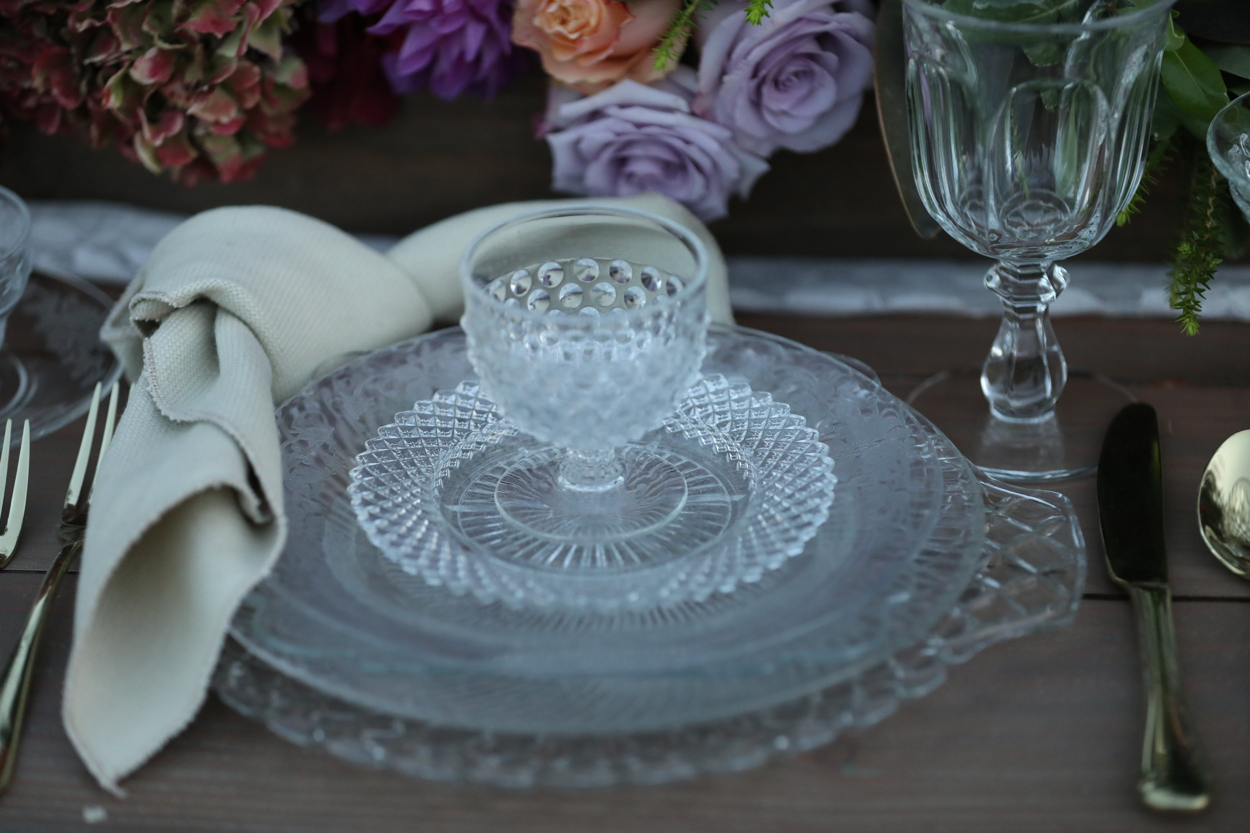 Cut glass charger plate set at a wedding table. Vintage wedding rentals.