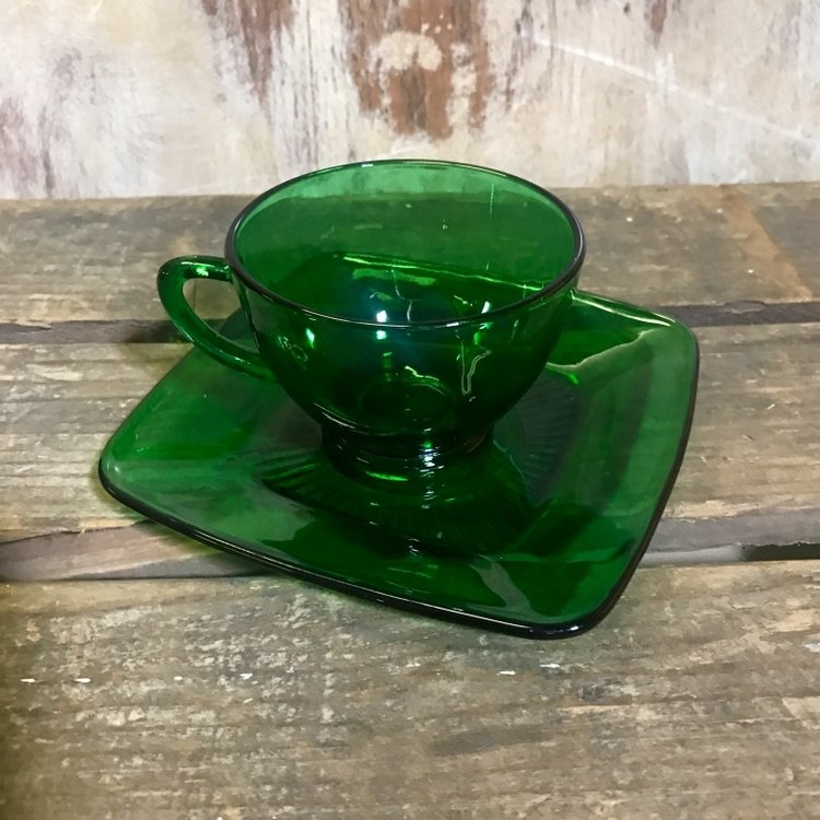 Green Glass Cup and Saucer   Anchor Hocking green. Square saucer. Comes in a set.