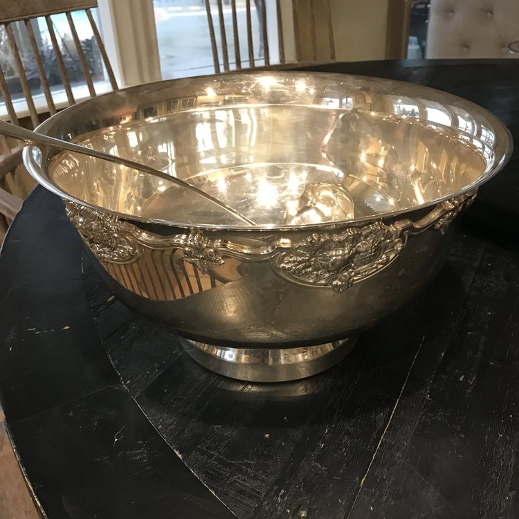 "Silver Punch Bowl   Baroque style silver plated punch bowl with ladle. Detailing around edge of top with a pedestal base. 15.5"" round x 8"" tall."