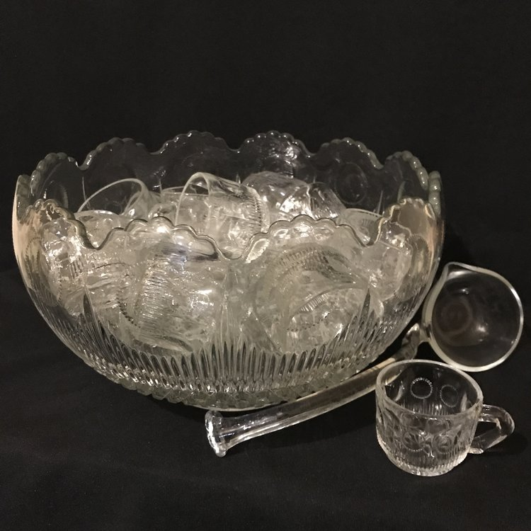 "Medallion Cut Glass Punch Bowl with cups   Heavy cut glass punch bowl with a round medallion embossed pattern. Scalloped top. Comes with ladle and 24 matching cups. 14"" round x 7.5"" tall."