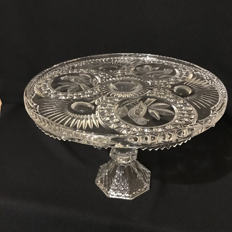 """Cut Glass Bird Pedestal Platter   Pedestal platter with three etched birds in the cut glass. It has an under scallop on the base of the plate itself and an octagon pedestal base. 12"""" round x 9"""" high."""