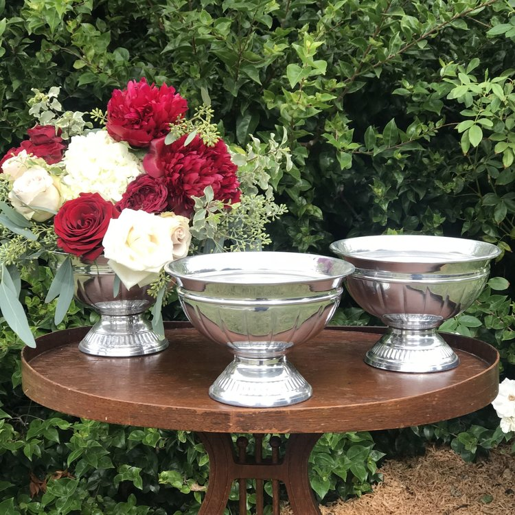 Silver Urns   Metal containers with a pedestal base. Great for floral.
