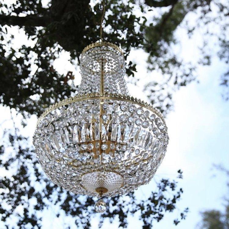 Patrice   Hollywood Regency gold teardrop shaped crystal chandelier.