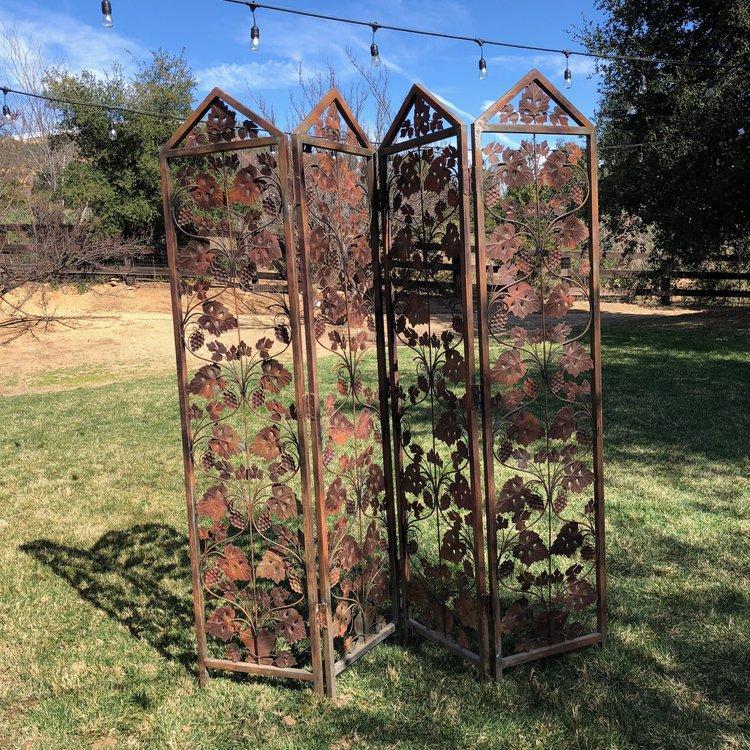 Shabby chic rust grapevine metal quad fold screen. Vintage rentals.